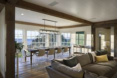 edison light fixtures Dining Room Beach with exposed beams farmhouse table linear chandelier open