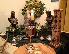 Altars:  Wiccan Ostara Altar with black and ivy altar cloth layered on top of ivory and gold cloth.