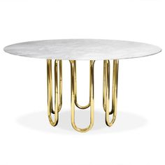"JONATHAN ADLER SCALINATELLA DINING TABLE Sculptural and surreal - two main themes running through New York designer Jonathan Adler's home collection. The Scalinatella dining table is crafted using a single brass tube base, exquisitely manipulated into the curvey base, topped with a solid Carrara marble top. Pure luxury for the perfect dining experience. Pair with the Jonathan Adler Rider dining chairs or Maxime dining chairs for a decadent look. Dimensions: diameter 54"" H 29.375&quot..."