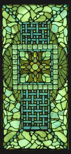 stained glass window in lots of shades of green