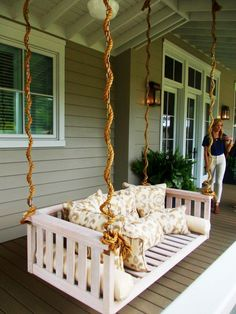 How inviting is this bed porch swing? Mama needs a dream nap spot and a mimosa, stat. Ballard Designs provided all the outdoor furnishings and with 2,800 square feet of porch space at the Idea House, there's a lot of furnishing to do.