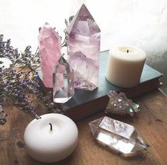 Lovely pink and purple altar with crystals and candles. We have a large selection of crystals to choose from. Come and create your own shrine. Will bring peace and harmony into the house. Crystal Altar, Crystal Decor, Crystal Magic, Crystal Healing, Soul Healing, Healing Quotes, Crystal Grid, Crystals And Gemstones, Stones And Crystals