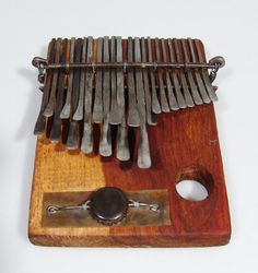 22 Key Medium Mbira Thumb Piano Kalimba Karimba - C.Vambe Handmade in Zimbabwe! by Cypren Vambe. $93.00. I recently returned from Zimbabwe where I had a chance to meet with Cypren Vambe and one of his sons Richard who produced a short performance which was fabulous. Hand made from a block of carefully selected wood which is stained and sun dried prior to making the mbira so as not to interfere with the instruments acoustics. It has 22 metal squarish keys and ha...