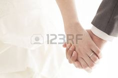 Holding Hands bride and groom at a wedding Stock Photo