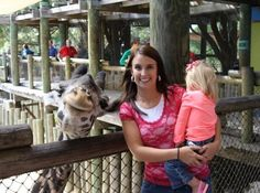 The giraffe is much more interested in being in this photo than the child is