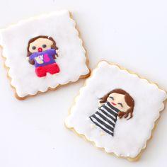 Sugar cookies decorated to look like Ingrid Nilsen and Miranda Sings!