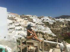 Relaxing on the balcony.  Oia village, Santorini island, Greece. - selected by www.oiamansion.com