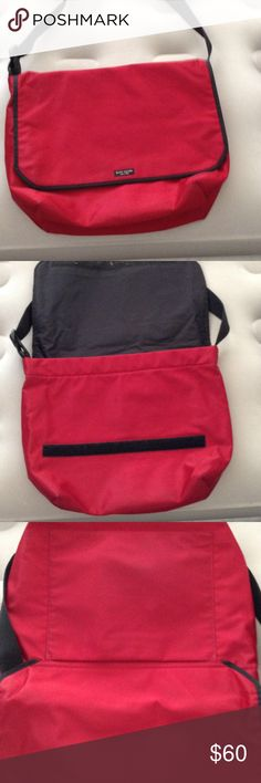Kate Spade messenger red bag Kate Spade red nylon messenger bad.    Clean. Pet free smoke free home.   Great travel bag.  Can be used as a diaper bag or as a laptop bag. 15 x 11.5 x 5.   No pad included kate spade Bags Laptop Bags