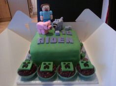 Minecraft 10th birthday cake with steve, pig and wolf models