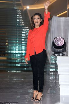 Always beautiful:Eva Longoria stunned in a red and black number as she unveiled her new c...
