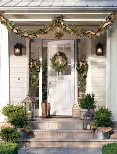 Create a welcoming front door with the natural warmth of burlap and pinecones on garland, swag and wreaths. HomeDecorators.com #holiday2012