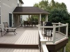Not only did this customer take advantage of our gorgeous material options, but we were also able to partially cover the deck to provide shade during the sweltering summer months! Covered Deck Designs, Backyard Patio Designs, Covered Decks, Back Deck Designs, Covered Porches, Pergola Designs, Backyard Ideas, Deck Makeover, Balustrades