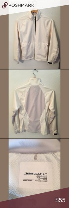 ⛳️Nike Pro Golf Full Zip Jacket⛳️ Worn only a handful of times and in perfect condition. Ivory with purplish gray accents. Velcro on the wrist to adjust to your size and hidden zippered pockets on the front so you won't lose your keys or tees on the course. There is a textured look to the fabric. Made of 100% polyester. Label says it's an XS (0-2) but I normally wear a medium (4/6) and it fits me perfectly. Nike Jackets & Coats
