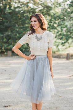 grey midi tulle skirt with a creamy top and a statement necklace