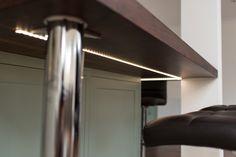 concealed LED lighting strip under a walnut breakfast bar Kitchen Reno, New Kitchen, Kitchen Ideas, Bottle Rack, Bespoke Kitchens, Larder, Minimalist Kitchen, Kitchen Furniture, Door Handles