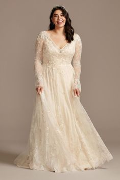 Crafted of airy Chantilly lace and adorned with floral appliques, this A-line wedding dress features a flattering V-neckline, sheer long bell sleeves, and a beautiful chapel train. Strapless Lace Wedding Dress, Plus Wedding Dresses, Wedding Dress Sleeves, Wedding Dress Styles, Plus Size Wedding Dresses With Sleeves, Size 12 Wedding Dress, Bridesmaid Dresses, Formal Dresses, Davids Bridal Plus Size