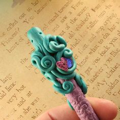 Been making polymer clay covered pens... and experimenting with octopus forms... (on Etsy, $18.50)