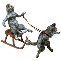 Gorgeous Vienna Bronze, Two Cats on a Fun Slid Ride, Mid-20th Century | From a unique collection of antique and modern sculptures at https://www.1stdibs.com/furniture/decorative-objects/sculptures/