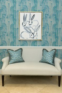 "The sofa is a little plain for me, but loving the wallpaper and the art!  -  Hunt Slonem Bunnies make any room ""hoppy""!"
