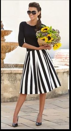 Solid boat-neck top, vertical striped skirt.  Love the side braid & glasses, too.  It would all be even better if it were navy and cream!