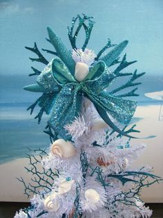 Seashell Coral Christmas Tree in a Whelk Shell~Starfish Christmas Tree~Coastal Christmas Decor! Welcome:) A fluffy White Pine Tee stands 16 inches tall inside a 9 inch long Whelk Shell! This fun Coastal design is adorned with zig zag Scallop Shells and assorted white Seashells~the