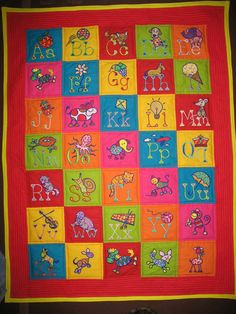 Quilt with machine embroidery alphabet designs.