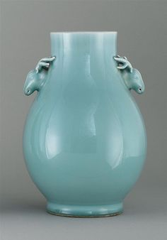 "CLAIR DE LUNE PORCELAIN VASE 20th Century  In pear shape with deer's-head handles. Six-character Qianlong mark on base. Height 13"" (33 cm)."