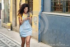 Girl walking on the street looking at her smart phone. Smiling Arab woman in casual clothes with black curly hairstyle Casual Clothes, Casual Outfits, Walking Street, Arab Women, African Girl, Black Curly Hair, Street Look, Walk On, Curly Hairstyle