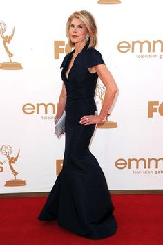 "Christine Baranksi  Grade: A    ""The Good Wife"" actress, 59, was regal in a polished, age-appropriate dark dress by Zac Posen, which she wore with a sparkly silver clutch, silver jewels, and classic red lips."