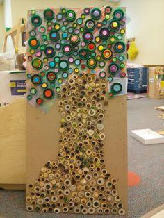 Preschool Kandinsky tree project...wooden circles, plastic lids and buttons.