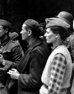 """PolishResistance membersCaptain Stefan Mich (""""Kmita"""") and Zofia Domańska (""""Zocha"""") of Company Koszta stand with fellow partisans on Moniuszko Street during theWarsaw Uprising. Warsaw, Masovian Voivodeship, Poland. 15 September 1944.Image taken by Eugeniusz Lokajski."""