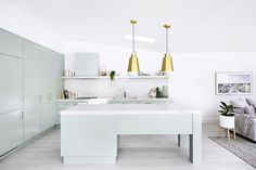 Pastel green kitchen by Three Birds Renovations. Story: Australian House & Garden