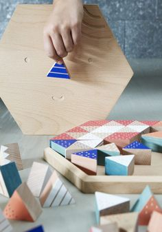 Wooden toy for children of an autistic parent