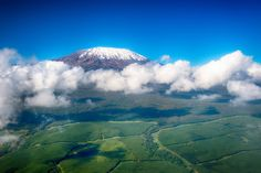 Aerial view of Mount Kilimanjaro (Shutterstock) - Provided by Wanderlust Mount Meru, Big Bucket, Mount Kilimanjaro, Aerial Images, Adventure Bucket List, Ultimate Travel, Aerial View, Tanzania, National Parks