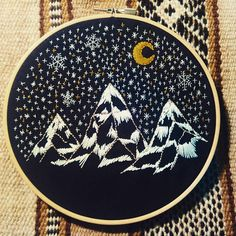 Snowy mountain, night sky, embroidery