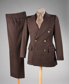 Pierre Cardin suit from 1973.  Oversize flap pockets, wide lapels, huge cravat and a narrow waist.  The ensemble reeks of sex in a wonderful way.  So different than modern skinny lapels---men should be peacocks not fragile flowers.