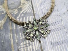 Evanoras Necklace - how to cover a neckloace cording with a chain and turn a brooch into a pendant