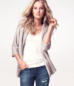 Loose-fitting jacket in glittery fabric with no buttons and 3/4-length sleeves
