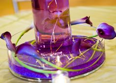 purple wedding centerpieces calla lillies w wire. wire is another cool way to bring in a color that you want but cant quite get w the flowers.