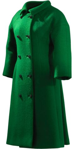 """""""DÍA"""" Coat, Cristóbal Balenciaga: 1963, French, silk and rayon chenille on a base of gauze. """"Made in the workshops in Paris in green Marescot chenille, this coat shows Balenciaga's skill in choosing the most novel fabrics to create his models with a classic and precise cut. The colour, the modern distribution of the pockets and the markedly geometric tubular silhouette are in perfect harmony with the 1960s aesthetic – a style that would later be developed by his disciple André Courrèges."""""""