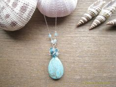 CM168-SOLD  Turquoise Pendant with drops of blue gems and crystals.