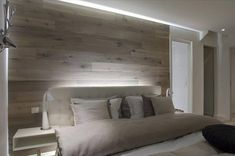 Love the boards used as the headboard, with the white glow and the light coloured bed spread