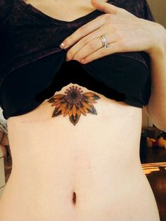 Attractive half sunflower tattoo under breast Sunflower Tattoo Shoulder, Sunflower Tattoo Small, Sunflower Tattoos, Sunflower Tattoo Design, Sunflower Mandala Tattoo, Sunflower Tattoo Meaning, Et Tattoo, Underboob Tattoo, Lotus Tattoo