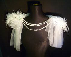 This White soft tulle and feather shrug is something a bit different for the bride that wants to WOW the guests. The feathers rest on the