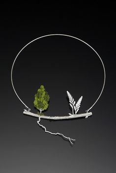 Root by Sarah Hood Jewelry from Landscape II Series | Cast sterling branch, cast sterling crocosmia flowers, cast sterling root, sterling cable, model railroad tree