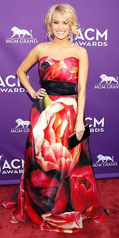 She normally dresses like a princess, but at the ACM Awards, Carrie Underwood is more like a prints-ess in a strapless floral Naeem Khan gown, worn with a Jimmy Choo clutch and heels and David Yurman jewelry. http://www.people.com/people/package/gallery/0,,20267558_20689007,00.html