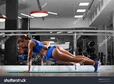 https://image.shutterstock.com/z/stock-photo-attractive-young-woman-is-doing-plank-exercise-while-working-out-in-gym-596597423.jpg