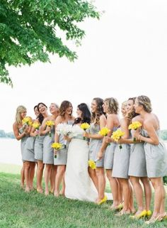 gray dresses and yellow flowers
