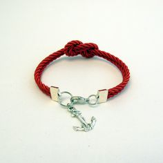Red infinity knot nautical rope bracelet with silver anchor charm