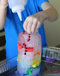Rainbow Ice Tower Excavation from Fun at Home with Kids -- love the addition of a chain!